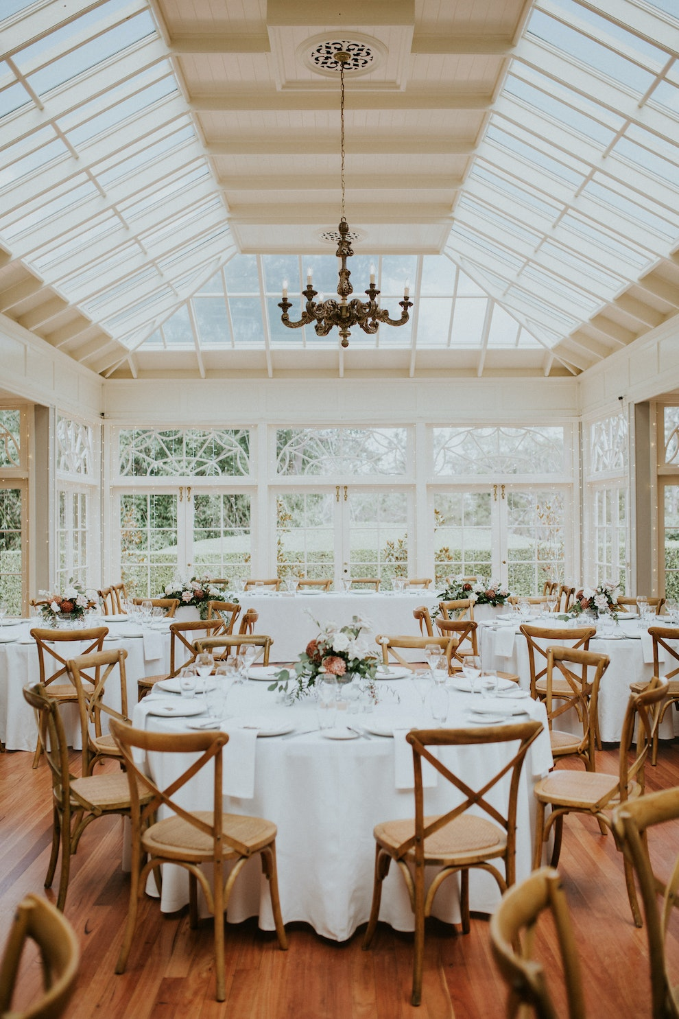 Wedding reception with round tables and wooden chairs