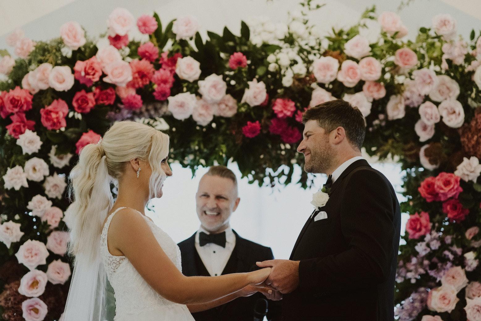 Bride and groom standing together at altar