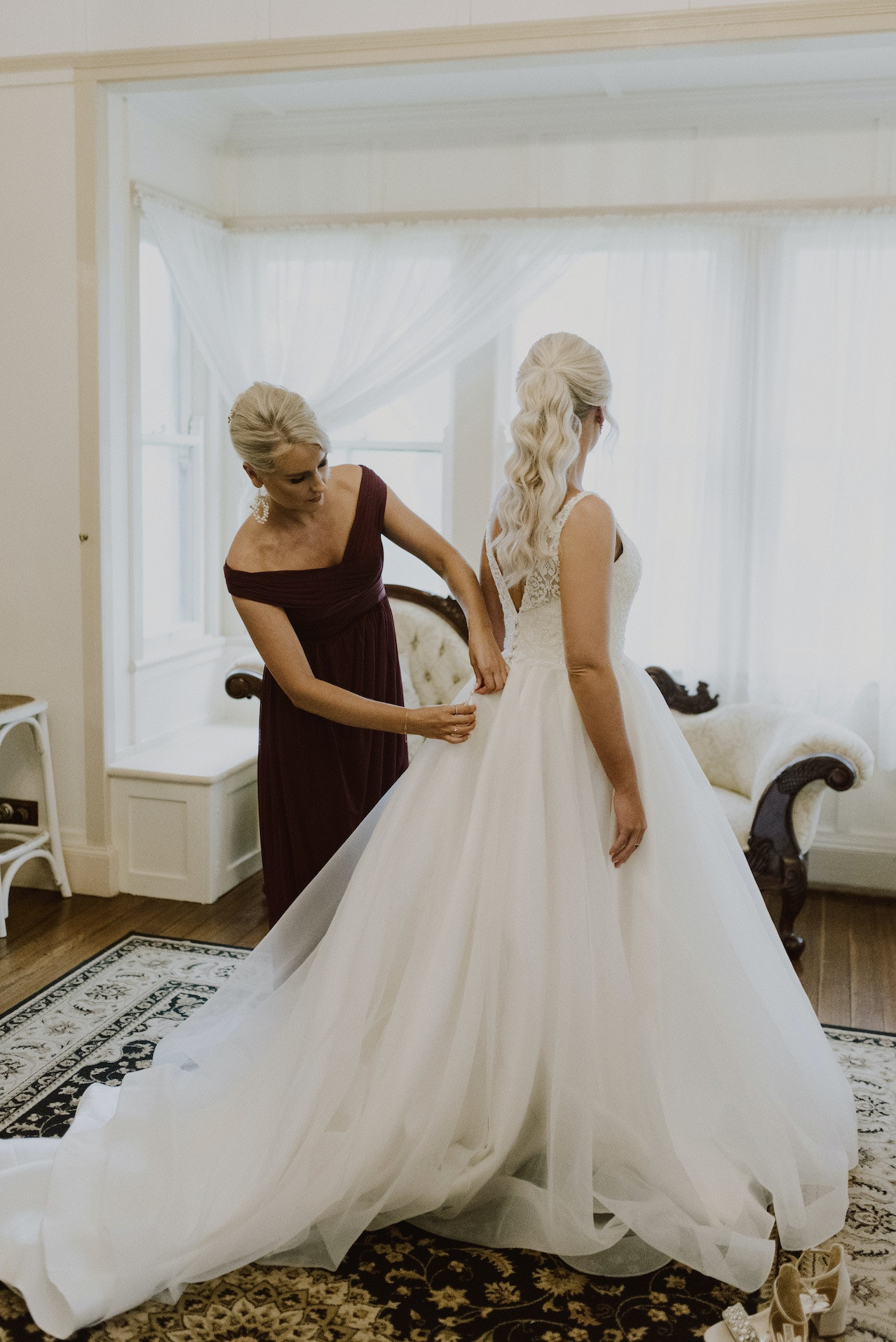 Bride getting dress buttoned up