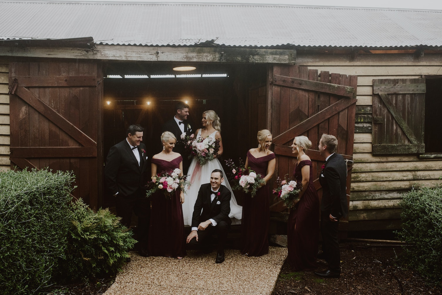 Wedding party getting photos in stable