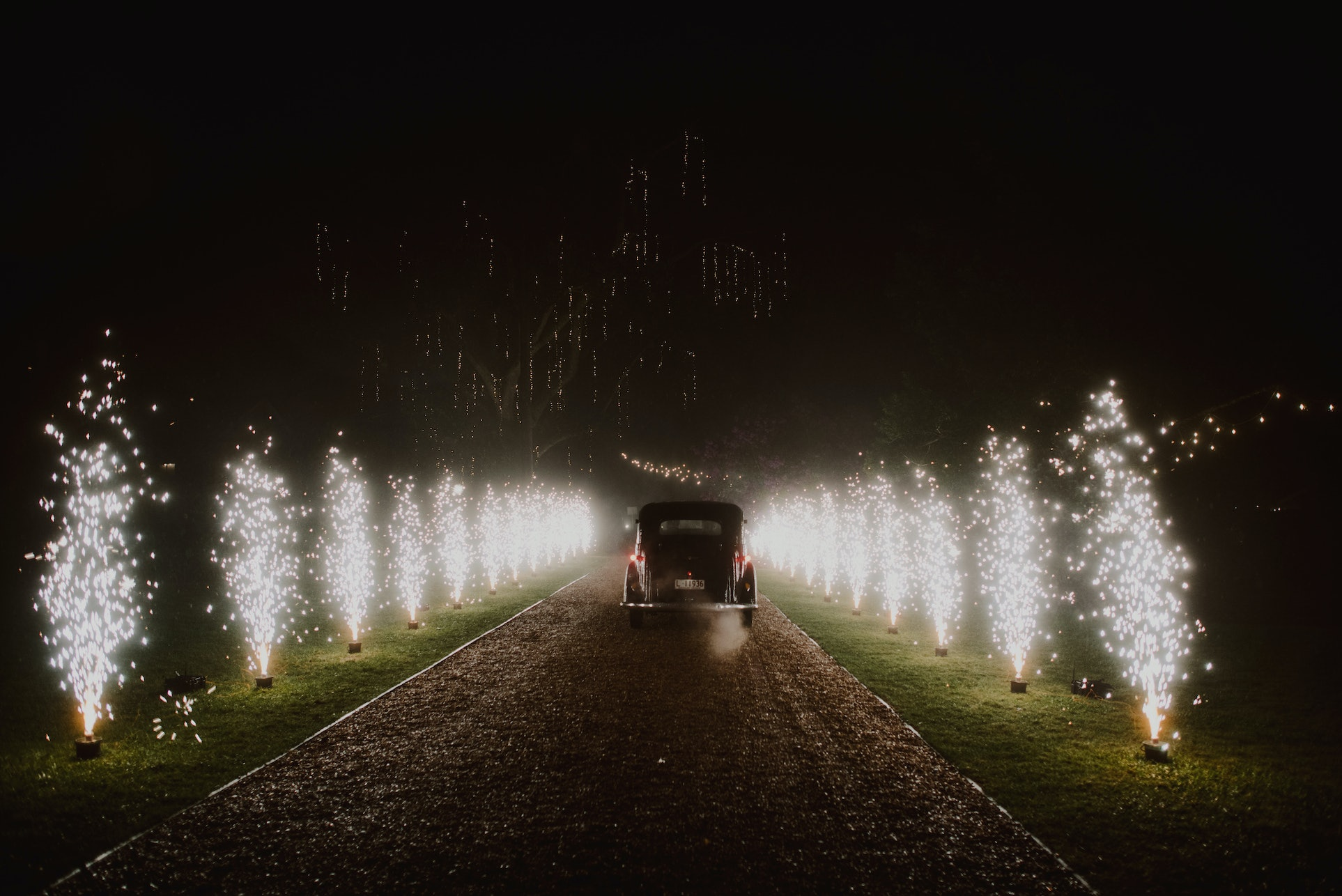 Wedding car surrounded by fireworks
