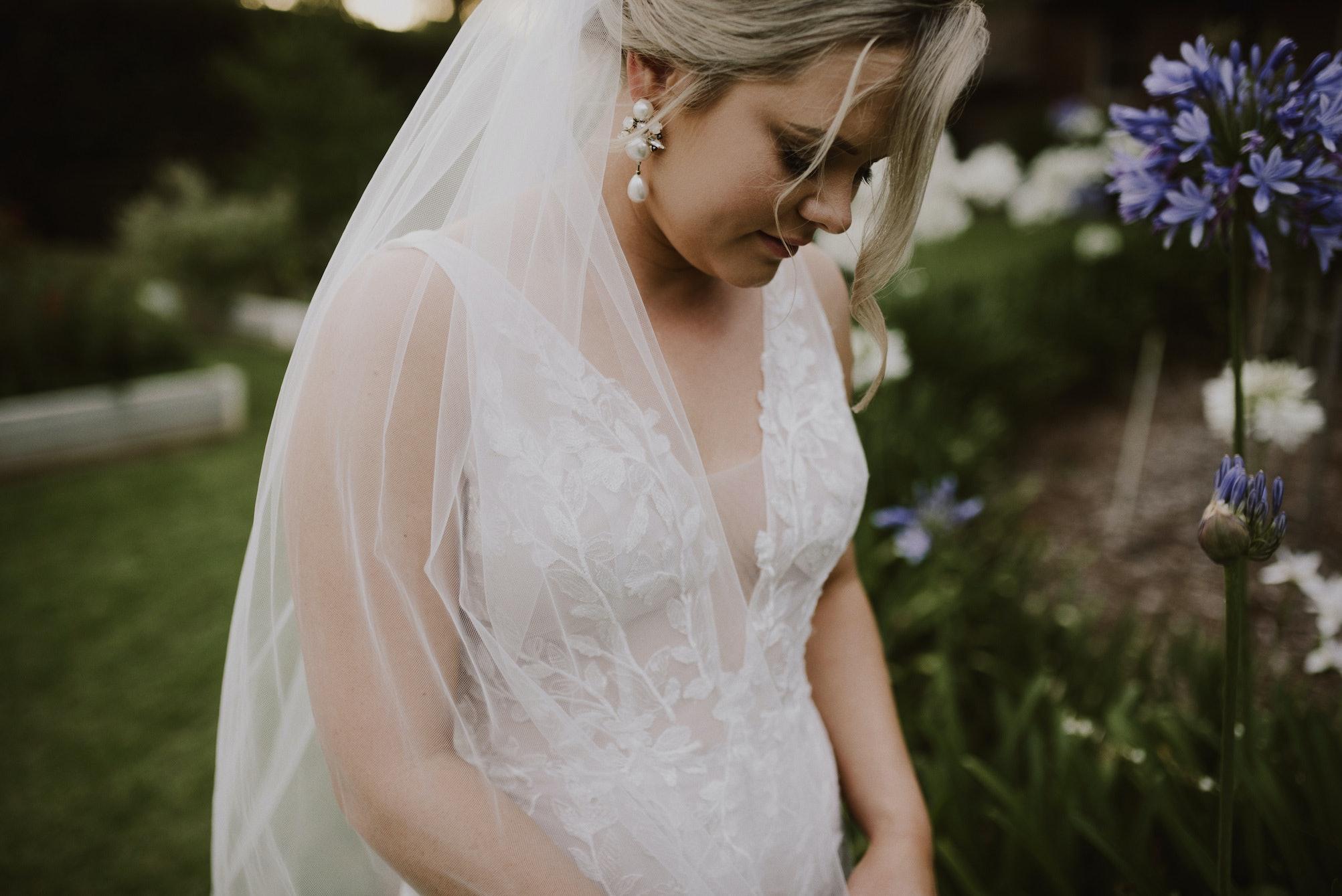 Bride walking through gardens