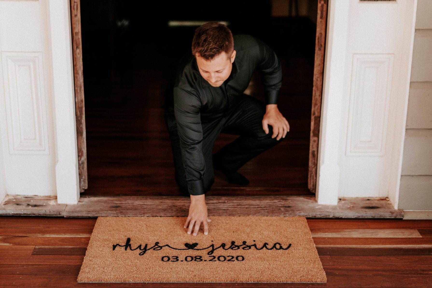 Groom with doormat