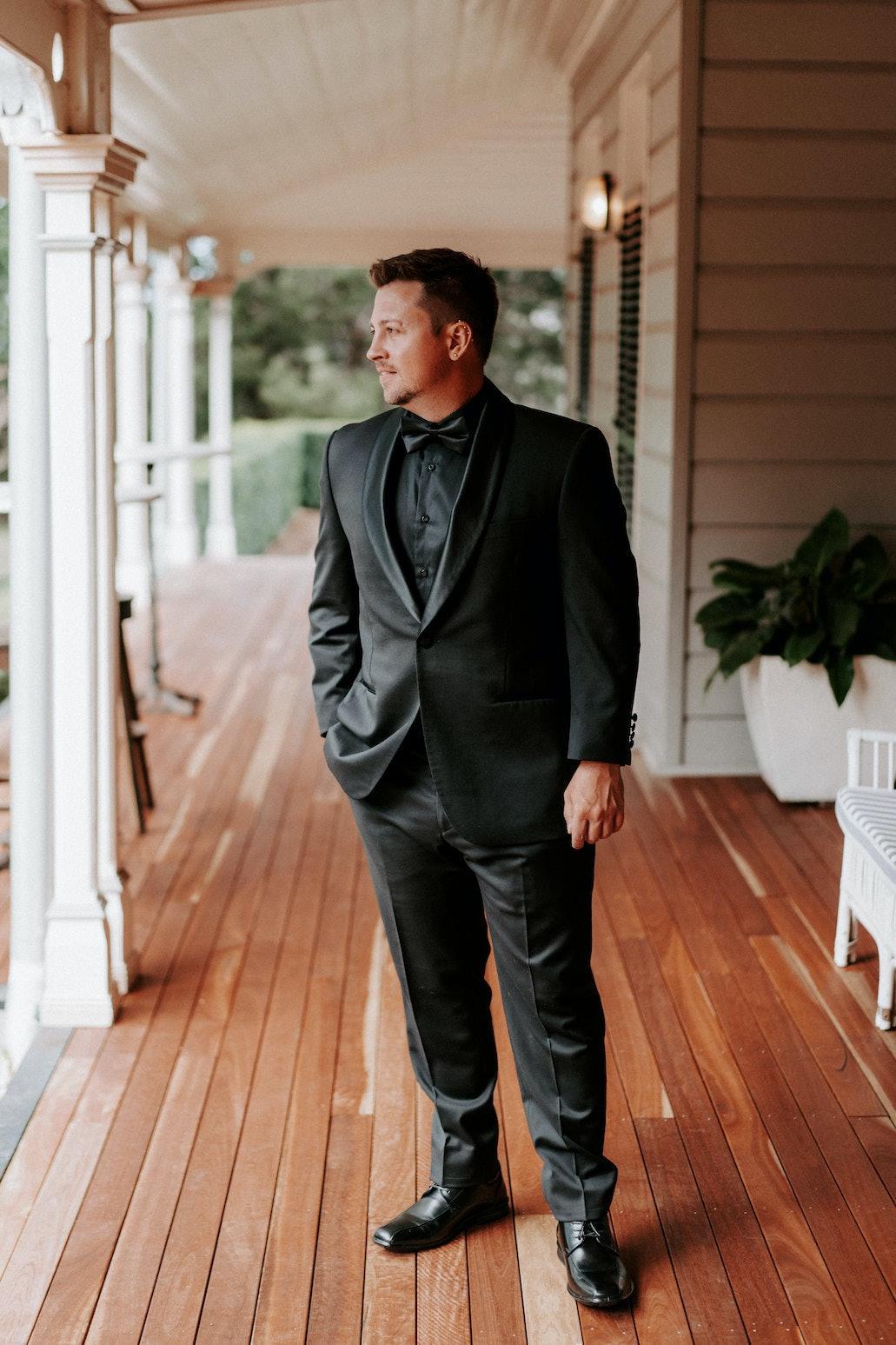 Groom standing on verandah
