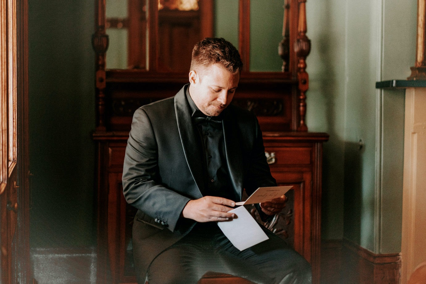 Groom reading letter