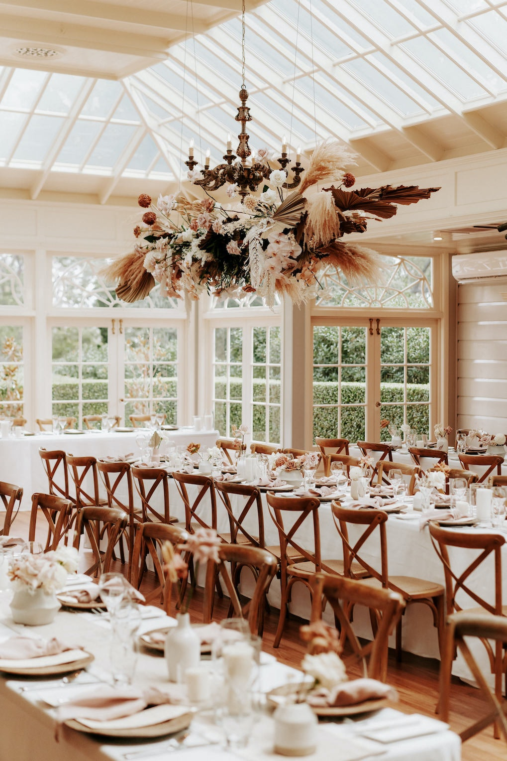 Wedding reception with hanging floral arbour