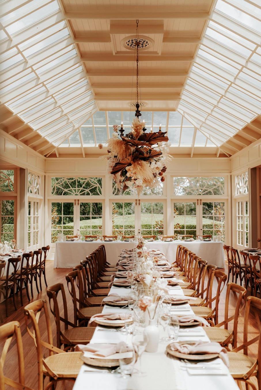 Indoor wedding reception with floral hanging arbour