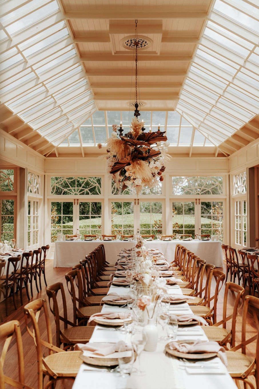 Wedding reception with floral hanging arbor
