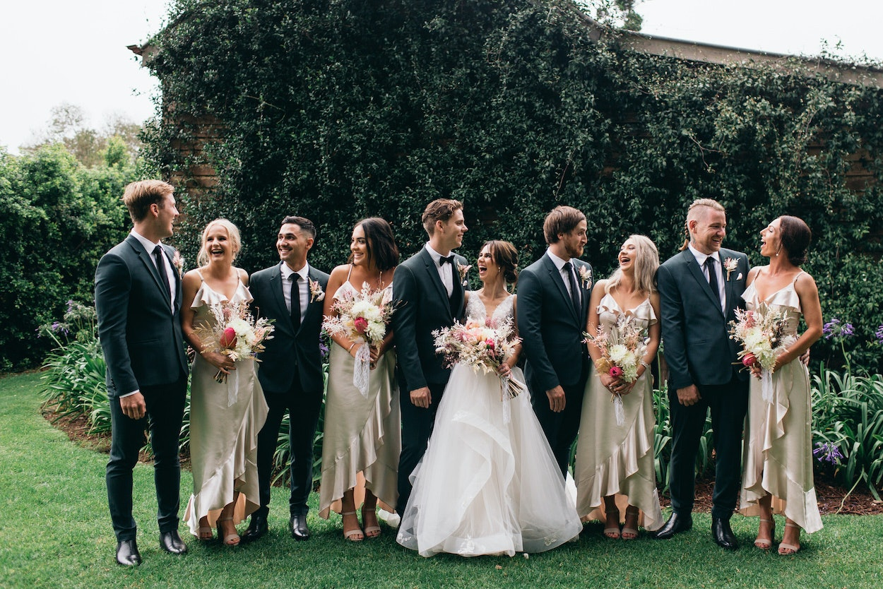 Bridal party laughing and posing