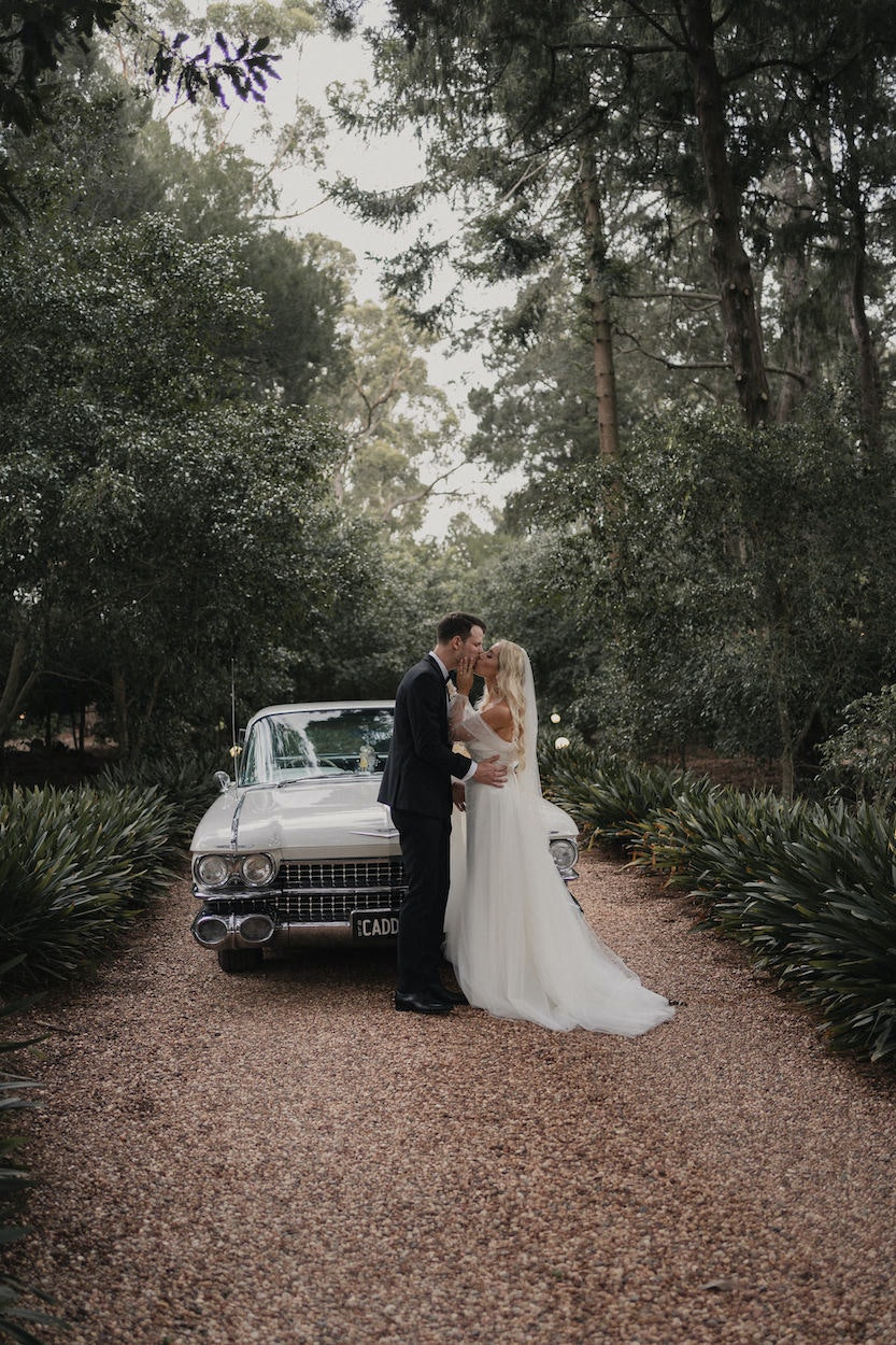 Bride and groom on driveway