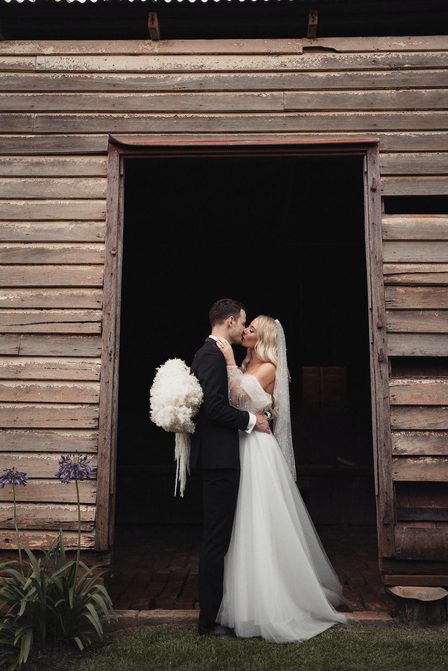 Bride and groom posing in doorway