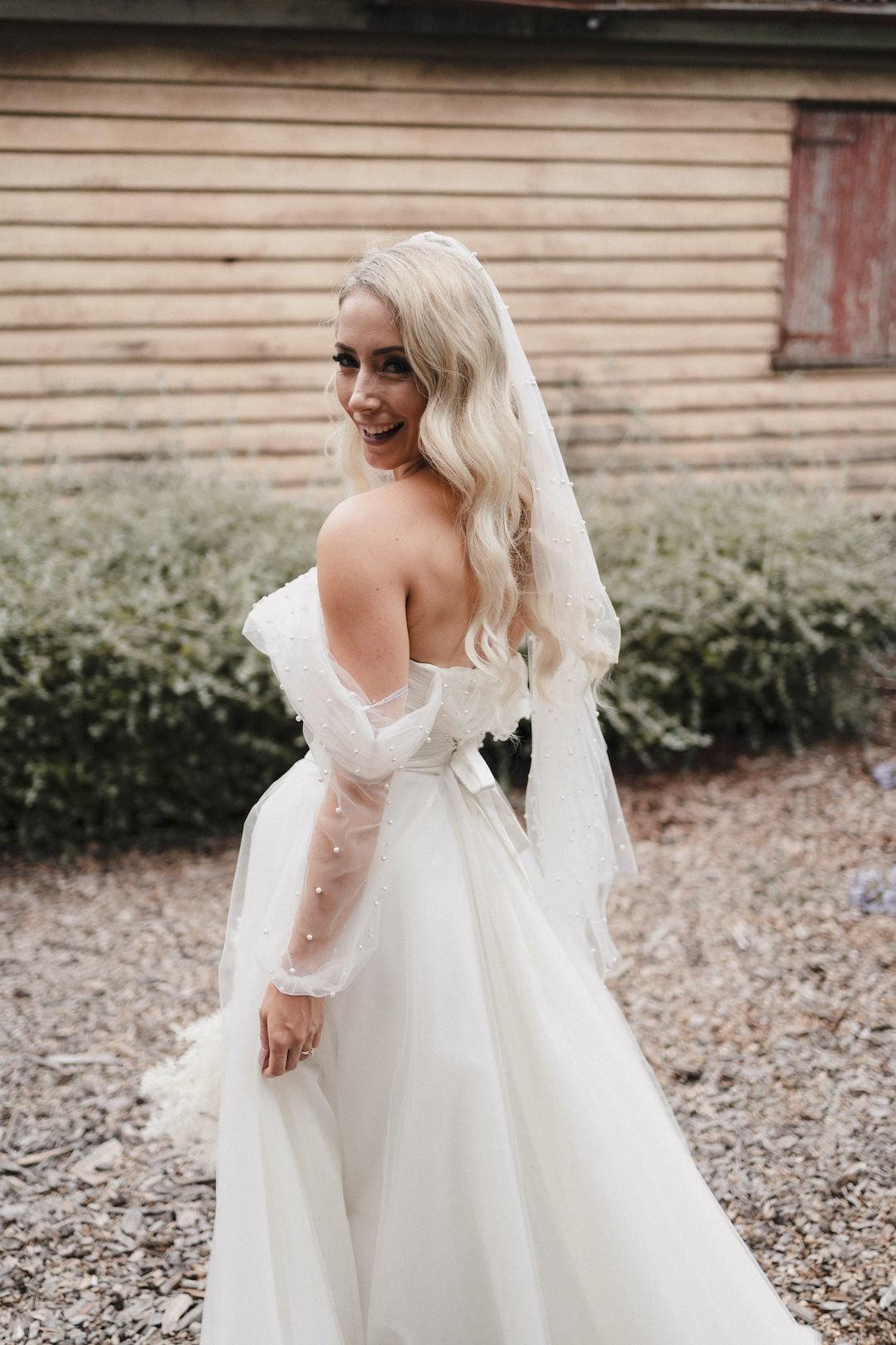Bride posing in dress