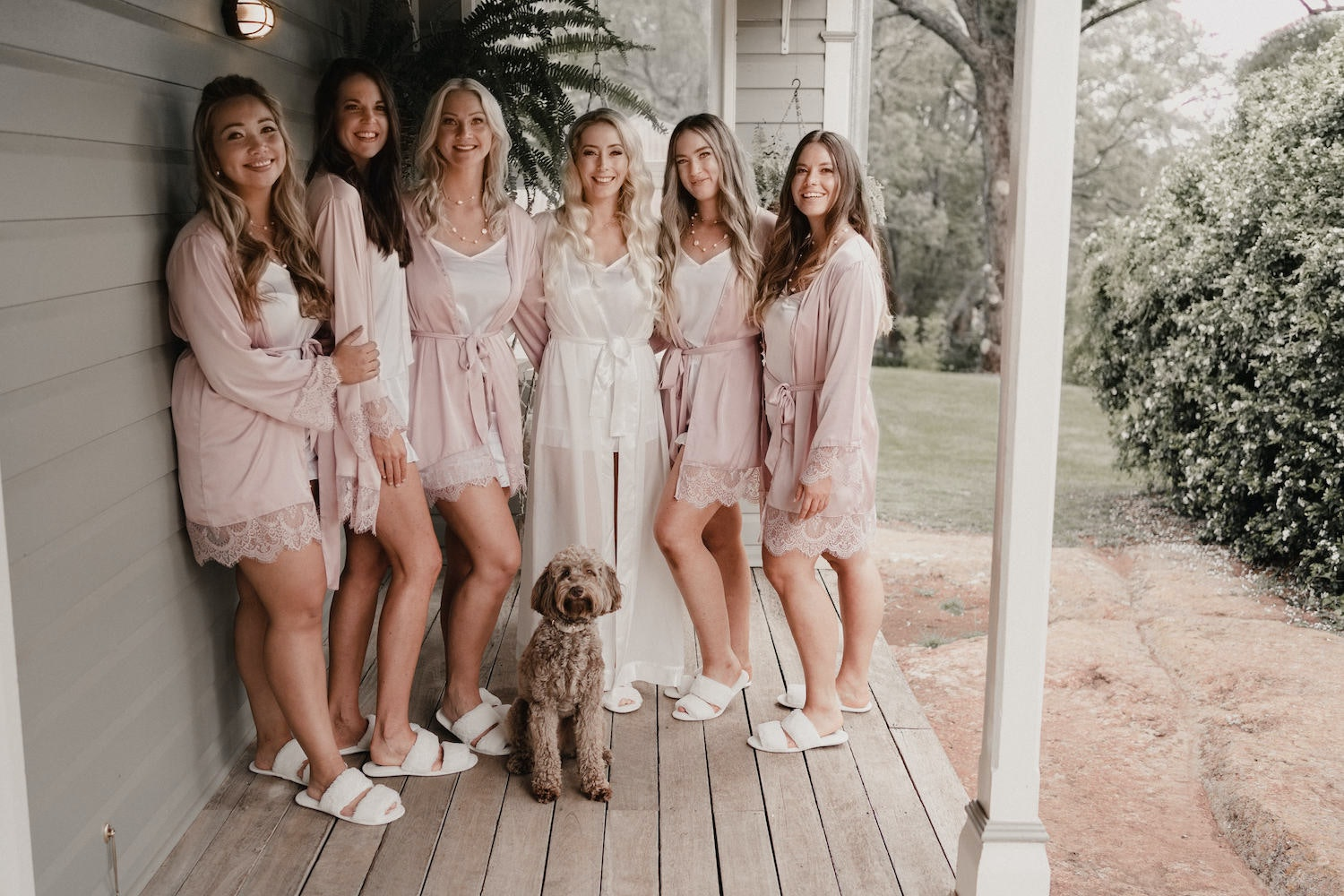 Bride standing on deck with bridesmaids