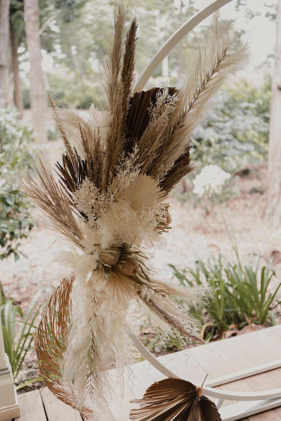 Dried flowers on wedding arbor