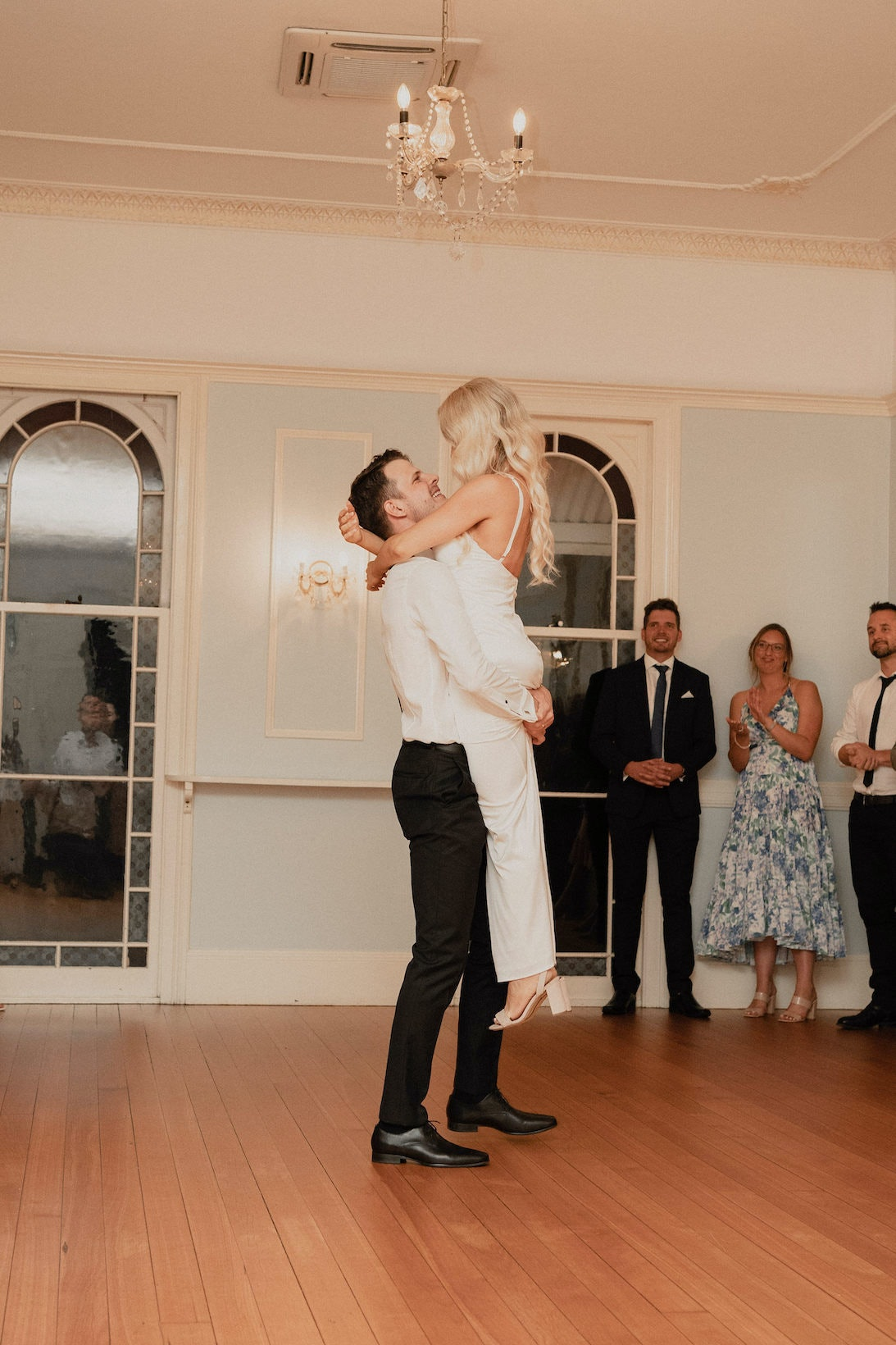 Bride and groom dancing in ballroom