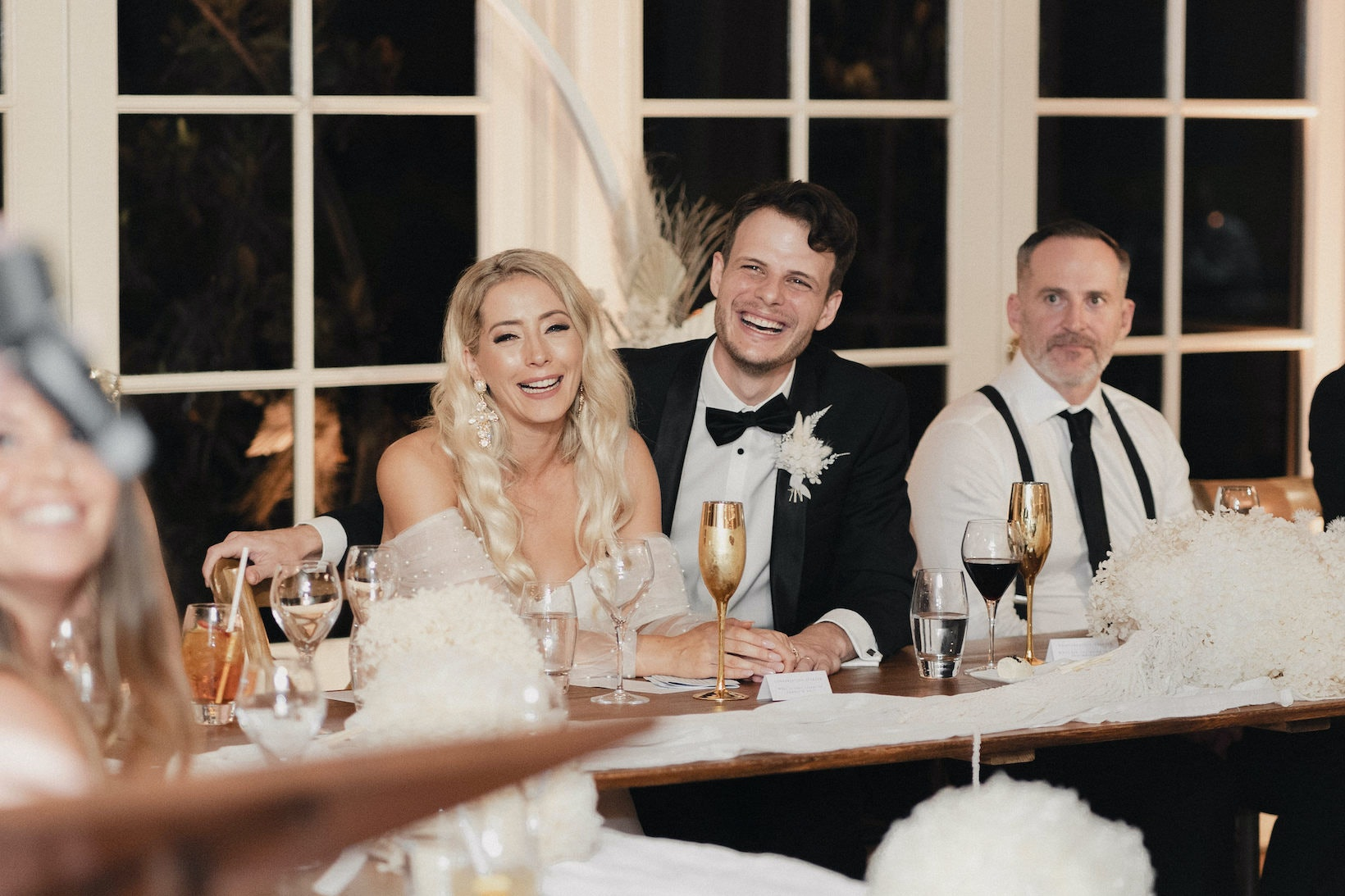 Bride and Groom sitting at bridal table