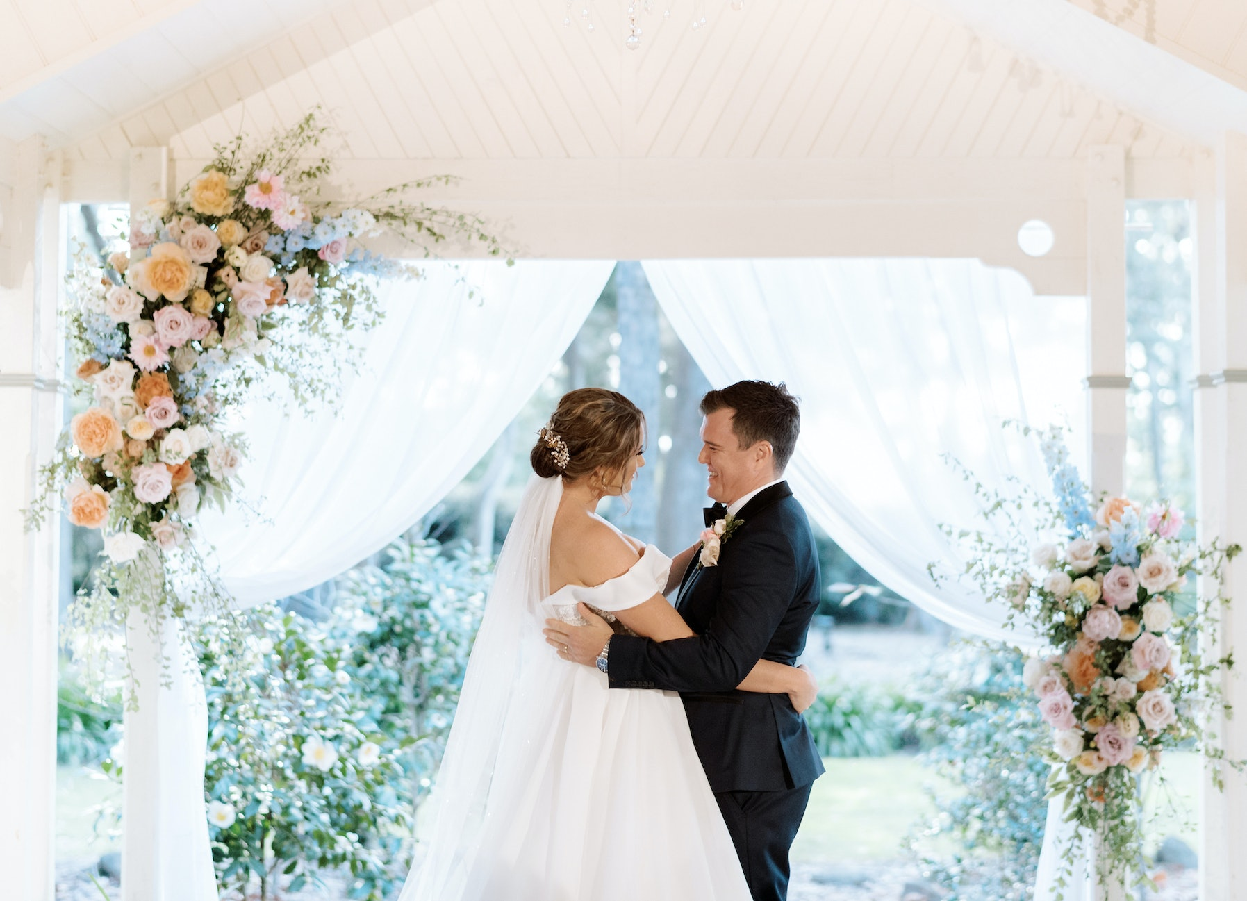 Bride and Groom standing at aisle