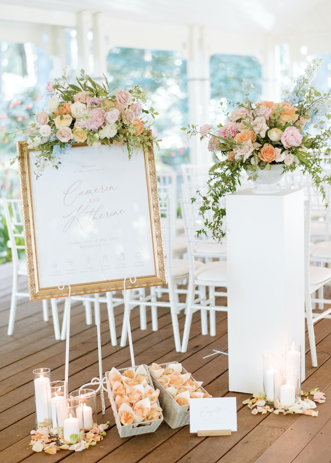 Wedding ceremony set with flowers and welcome signs