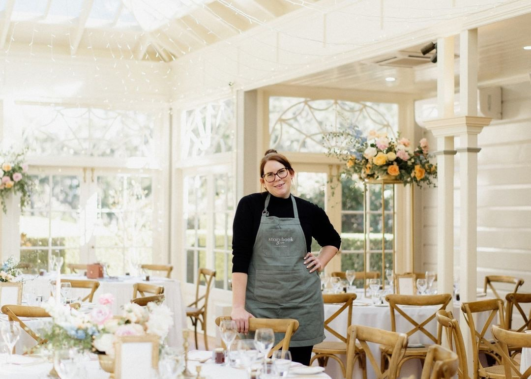 Wedding planner standing at wedding tables