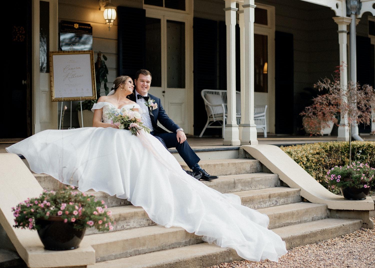 Bride and groom sitting on steps