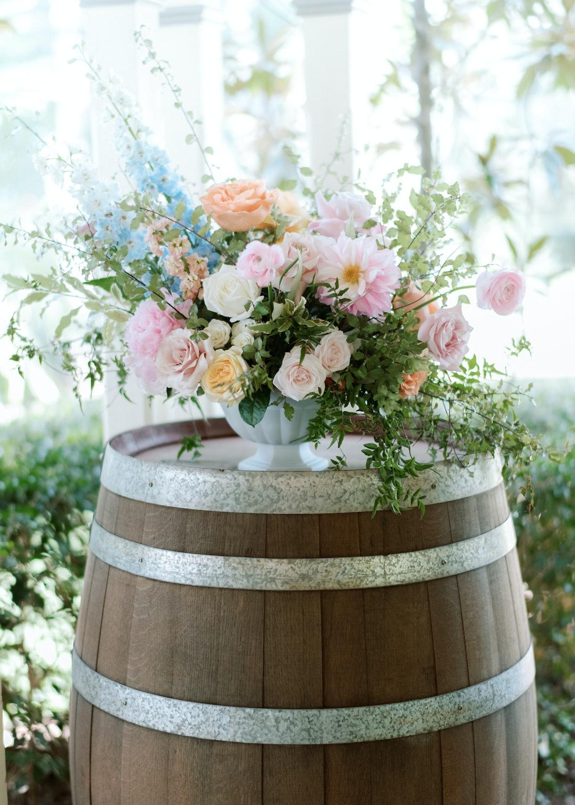 Wedding flowers on wine barrel
