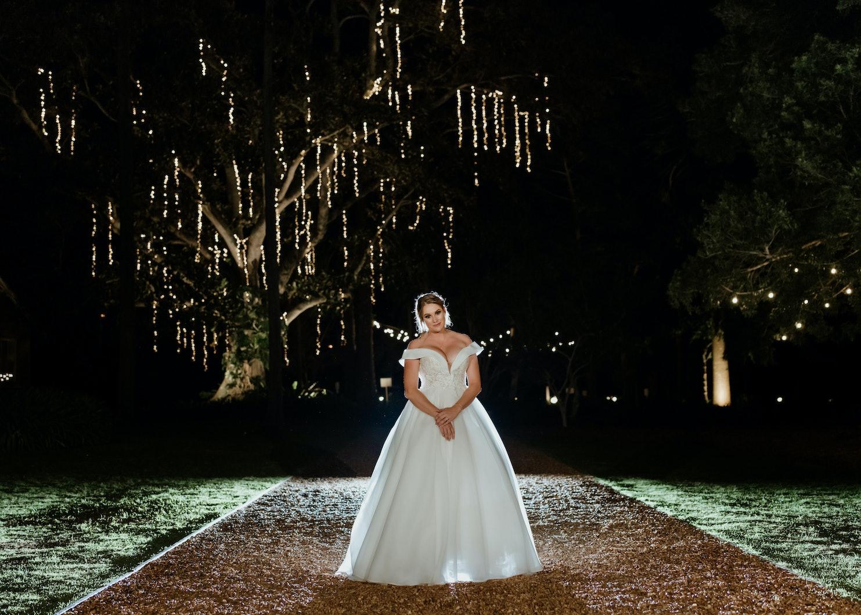 Bride standing in night garden