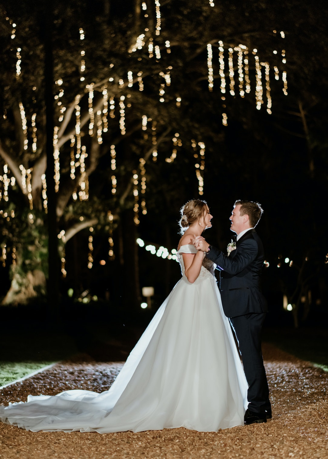 Bride and groom dancing at night