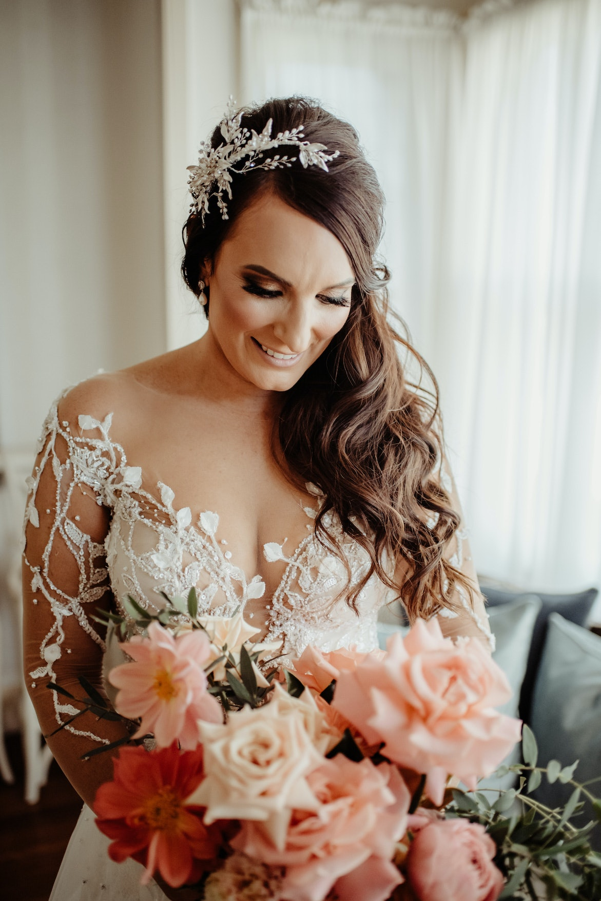 Bride smiling looking down at bouquet