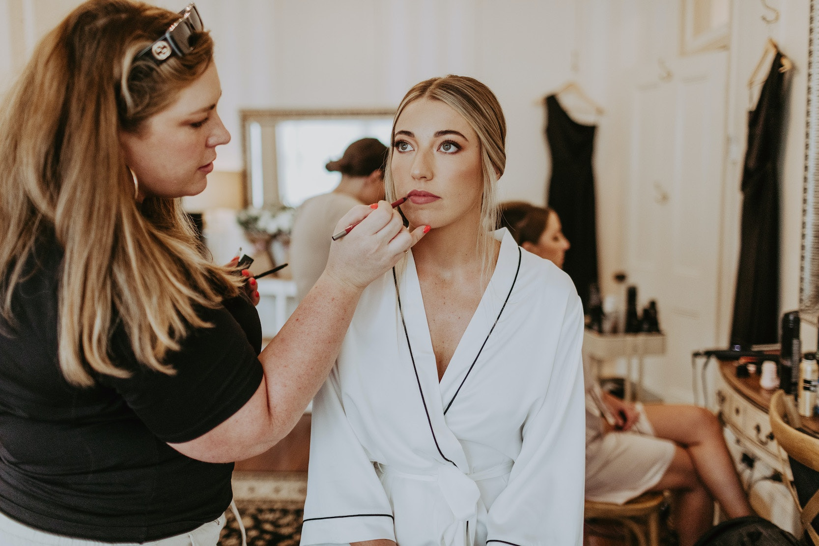 Bride getting makeup applied to her eyes