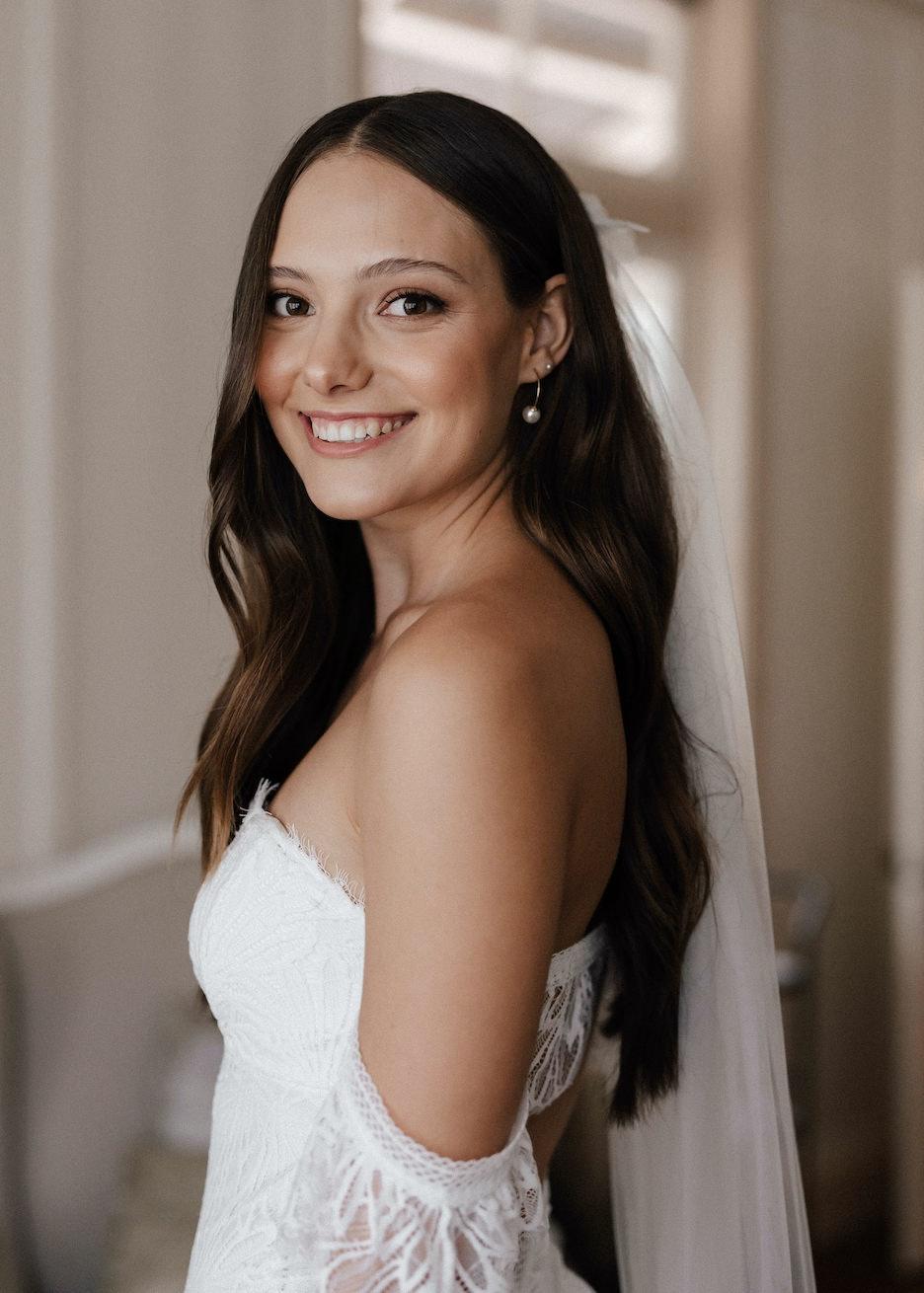Bride smiling and looking at camera