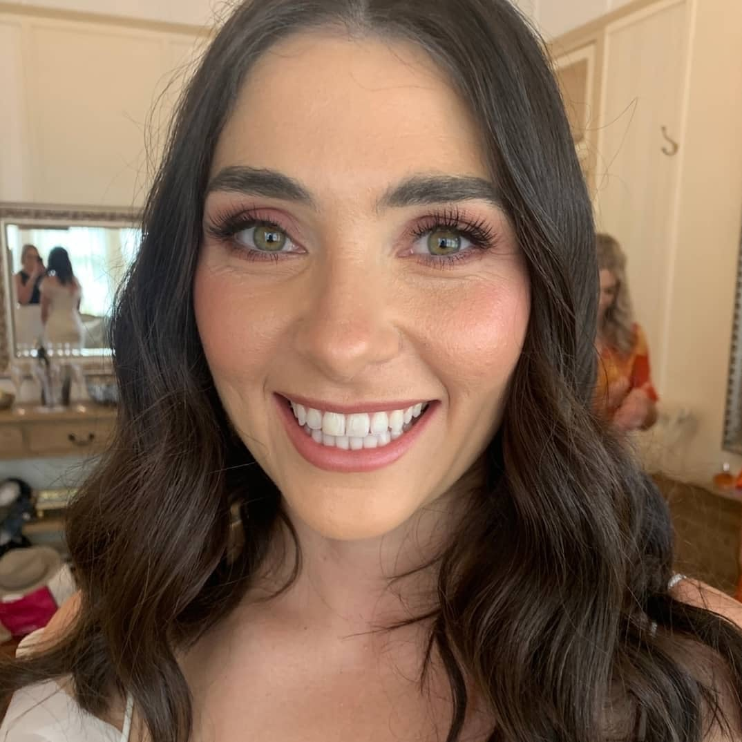 Bride smiling with makeup on