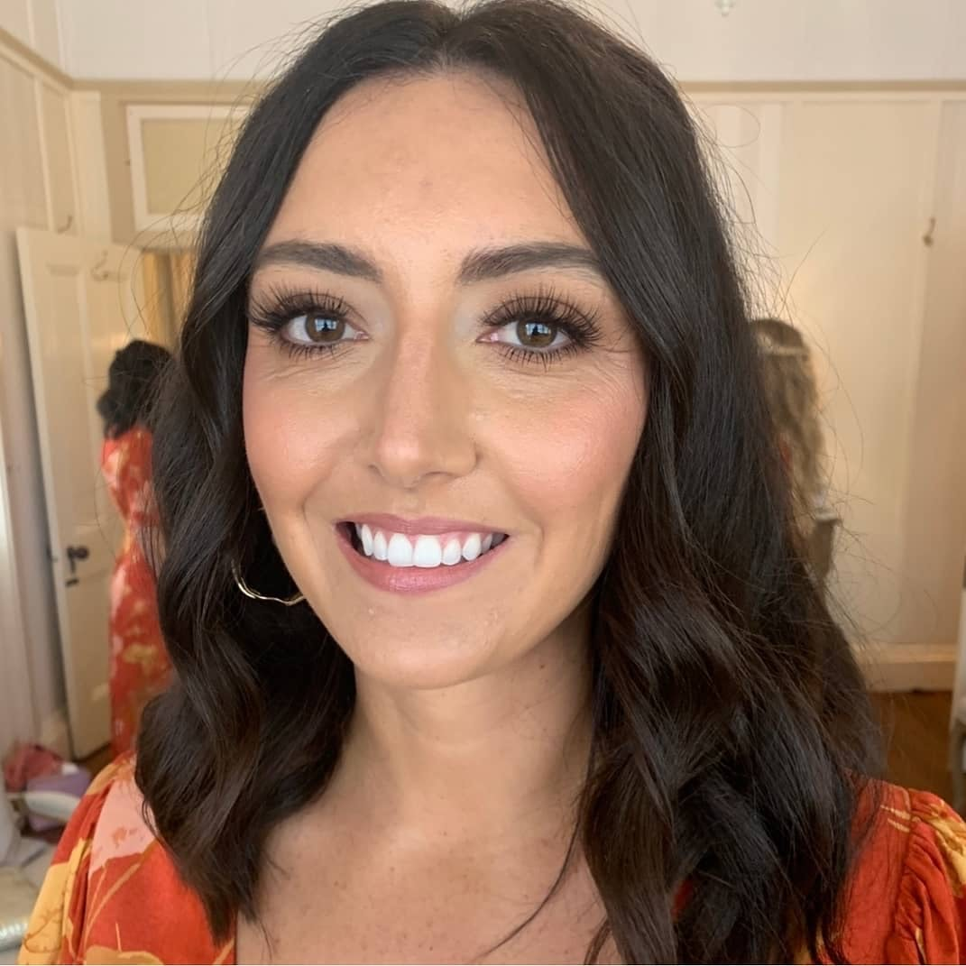 Bridesmaid smiling with makeup on