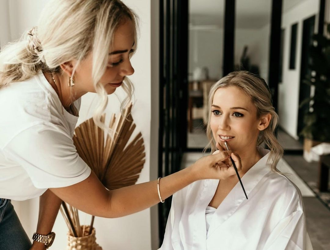 Bride getting makeup applied