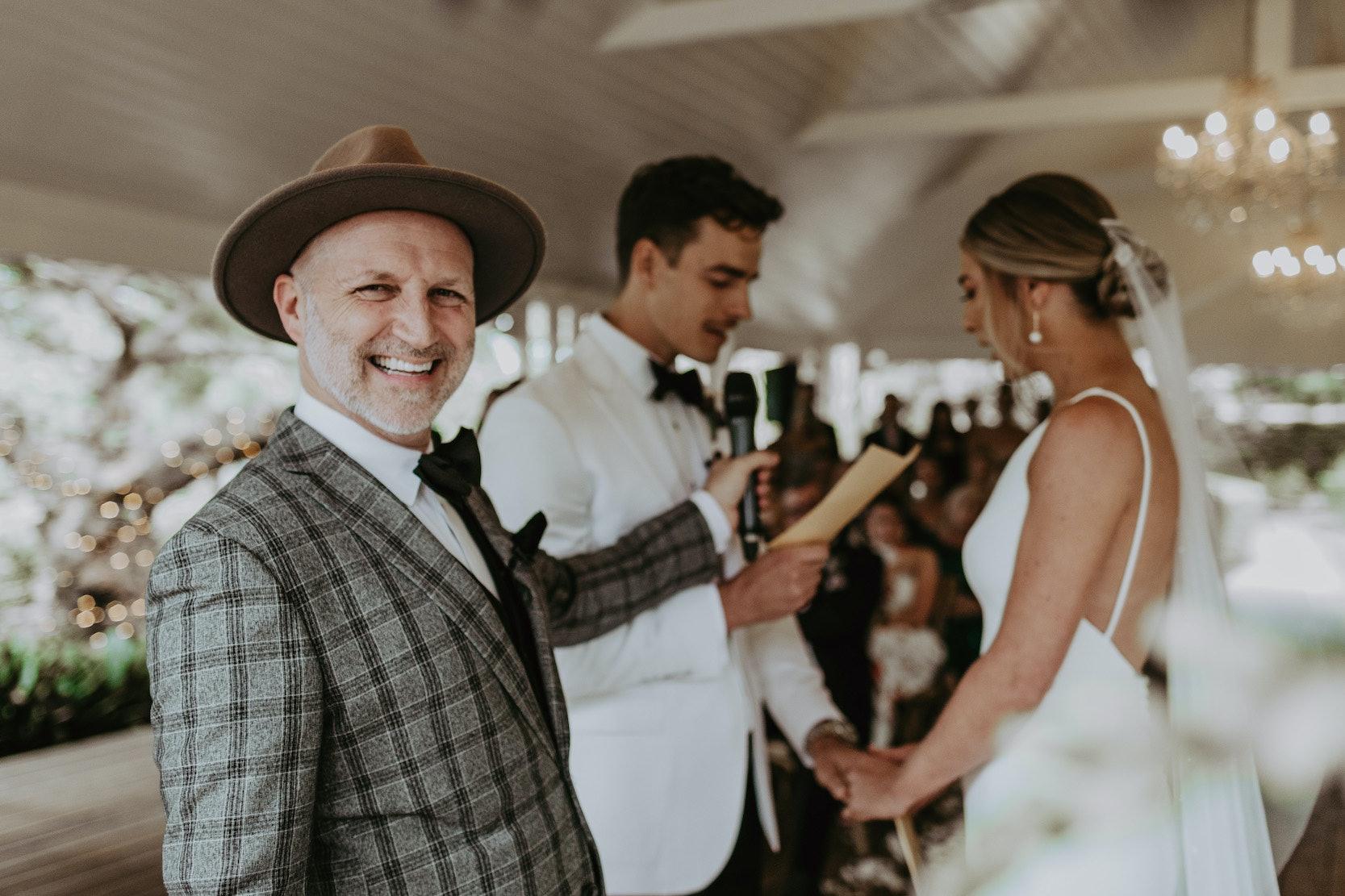 Wedding celebrant smiling at camera