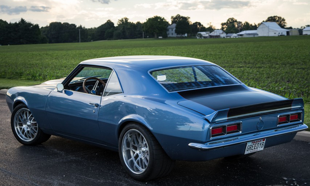 1968 Camaro featuring original style seating with a SPORT-X Hounds-tooth design. Includes matching door panels and center console.