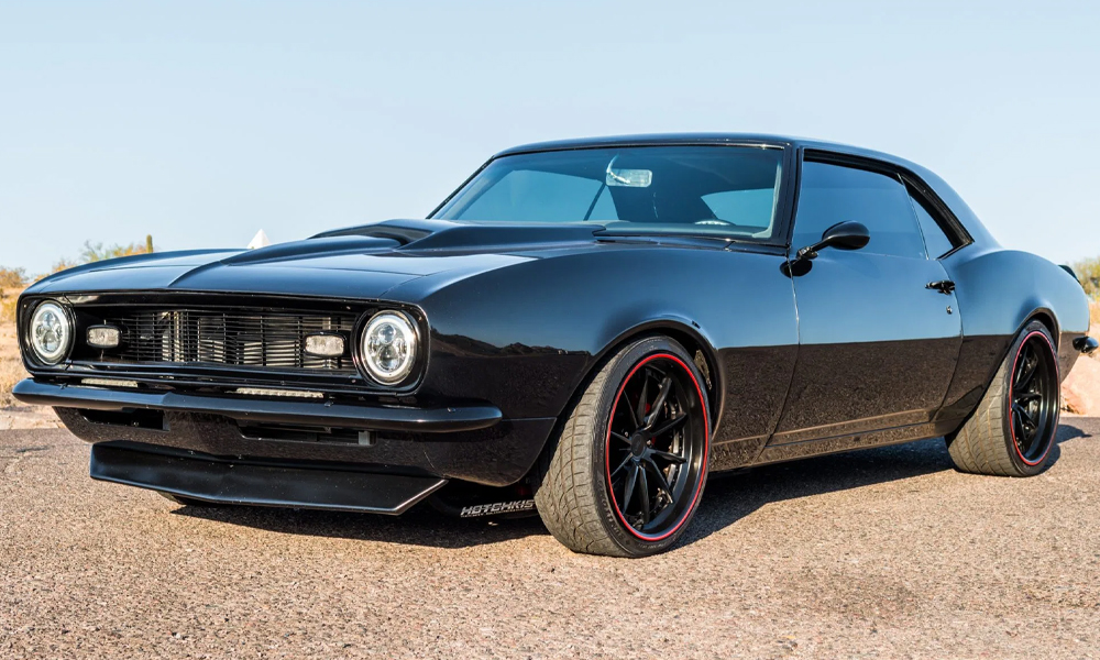 1968 Camaro featuring Universal Pro Series Low Back seats with SPORT-R design including black vinyl, gray suede, and red contrast stitching. Paired with matching rear seat, door panels, center console, and dash pad.