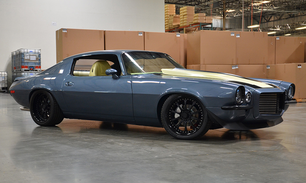 1970 Camaro featuring Universal Pro Series High Back seats with SPORT-XR design with yellow and black perforated vinyl, black  suede, black contrast stitching, and black grommets. Includes matching rear seat, center console, door panels, and dash pad.