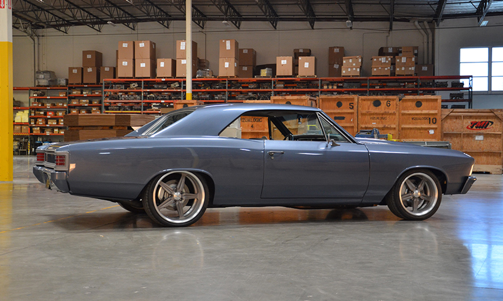 1967 Chevelle featuring standard SPORT-XR seats with off-white and dark gray perforated vinyl, off-white suede, and silver grommets. Includes matching rear seat, center console, door panels, and a headliner.