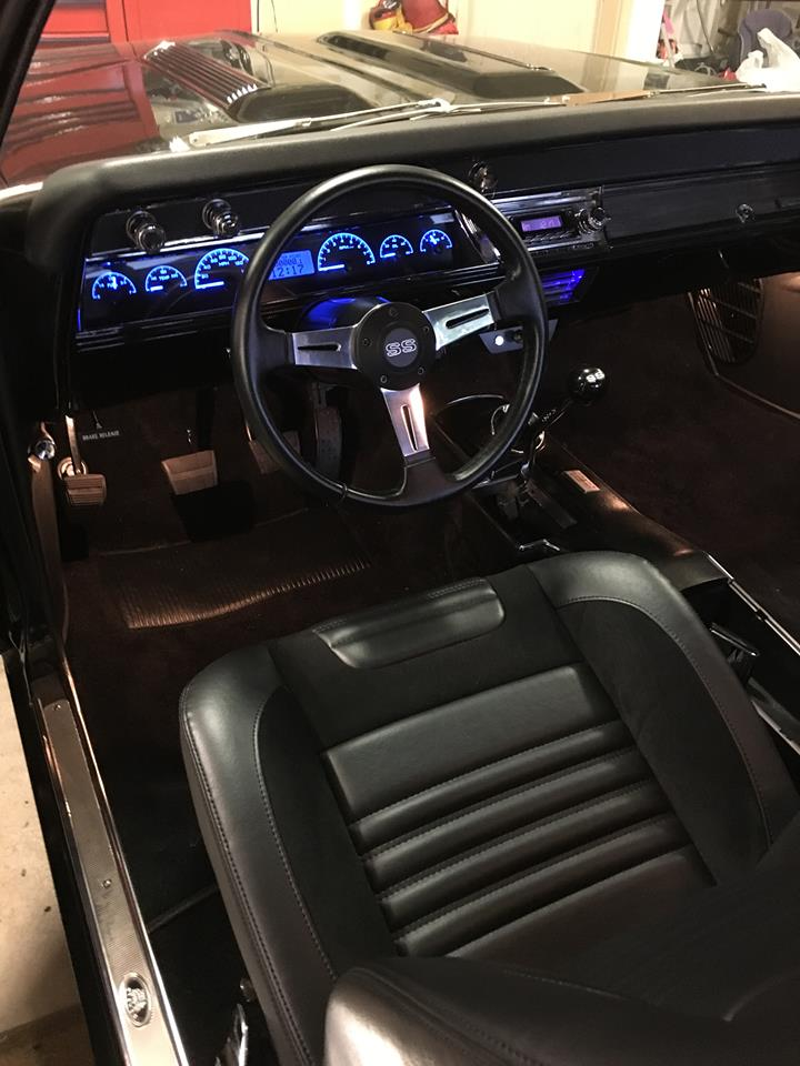 1967 Chevelle featuring stock seat frames, standard horizontal SPORT-R seats with black vinyl and black suede. Includes matching rear seat, center console, and door panels.