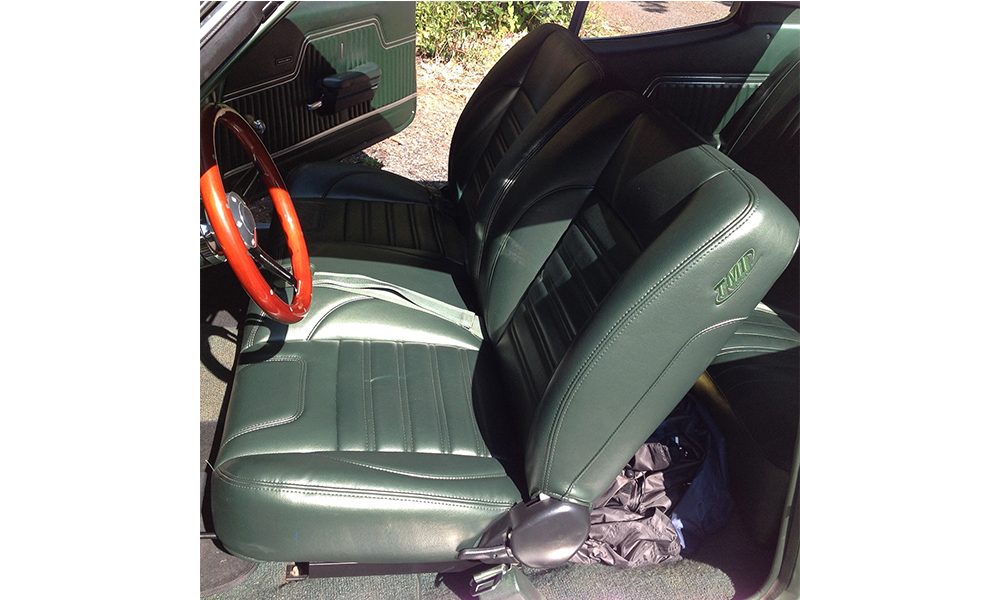 1970 Chevelle featuring replacement standard SPORT bench seats with green vinyl. Includes matching door panels.