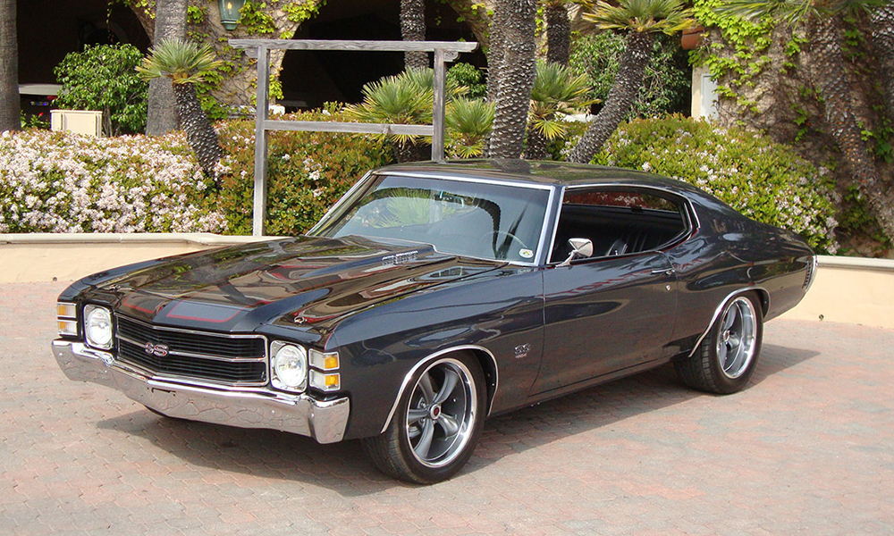 1971 Chevelle SS featuring replacement standard SPORT -R seats with black vinyl, black suede, black perforated vinyl accents, and white contrast stitching. Includes matching rear seat.
