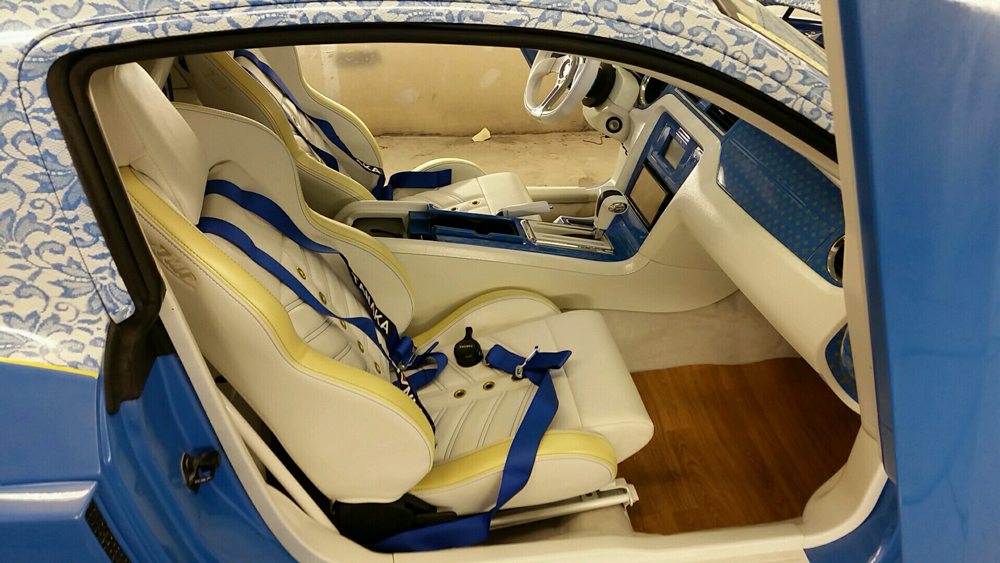 2012 Mustang featuring SPORT-VXR seat design with yellow vinyl, blue contrast stitching, and gold grommets.