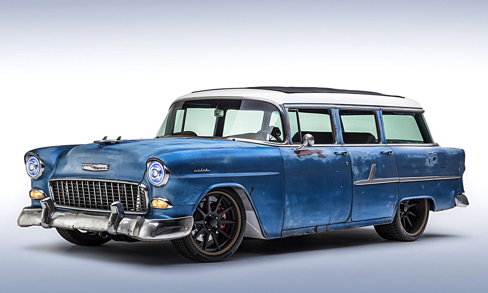 1955 Chevy Wagon featuring the SPORT-VXR design with distressed brown vinyl, white contrast stitching, and silver grommets. Inclues matching console, dash pad, door panels, carpet kit, rear seat, and steering wheel.