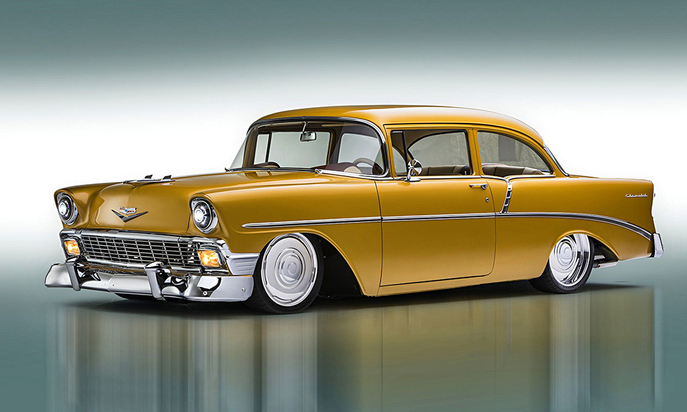 1955 Chevy 210 featuring Universal Pro Series Low Back seats in SPORT-AR design with tan and brown vinyl and yellow contrast stitching. Includes matching console, dash pad, carpet kit, steering wheel, rear seat with waterfall console, and trunk kit.