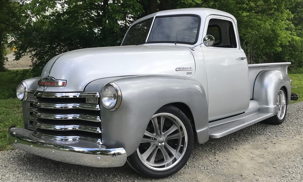 1950 Chevy Truck featuring Universal Pro Series bench in SPORT design with built in console. Features black vinyl and white contrast stitching with matching SPORT door panels.