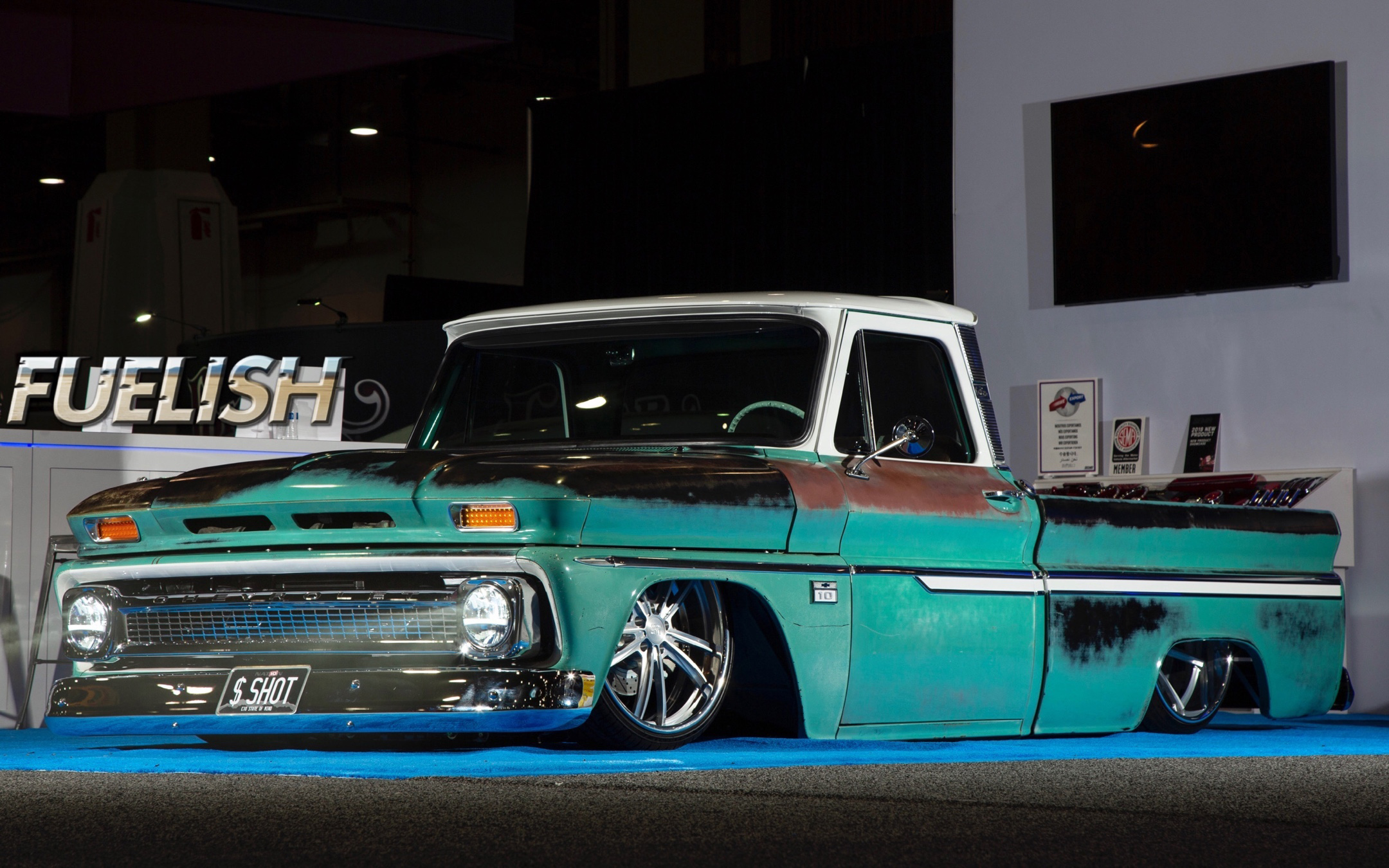 1966 Chevy C10 featuring Universal Pro Series bench in SPORT-LR design with camel vinyl, white contrast stitching, and white accents. Includes matching dash pad and SPORT-VXR door panels