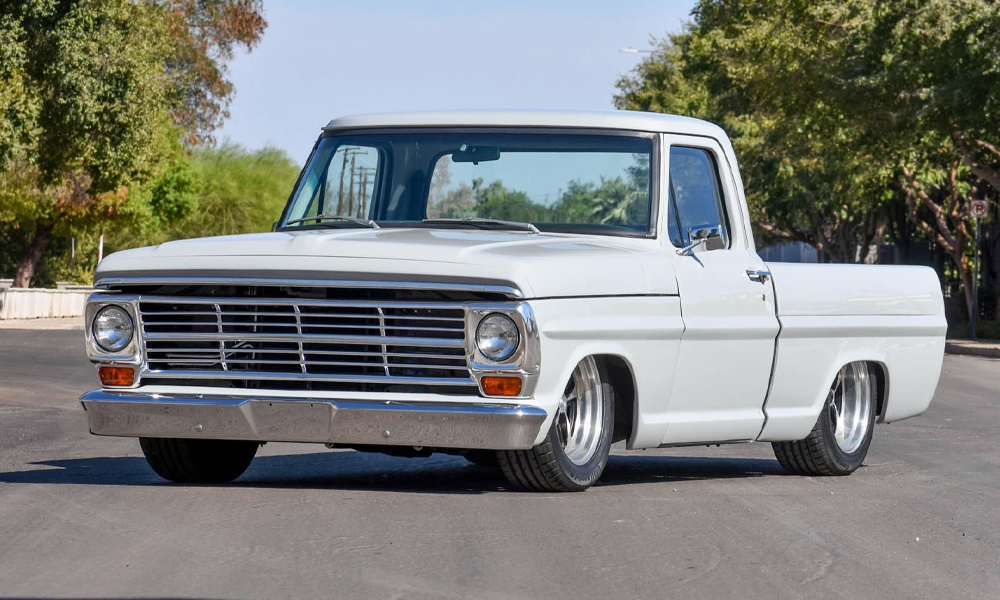 1968 Ford F100 featuring SPORT-XR seat design with black vinyl, black suede, black contrast stitching, and black grommets. Includes matching dash pad, headliner, sun visors, and SPORT-R door panels.