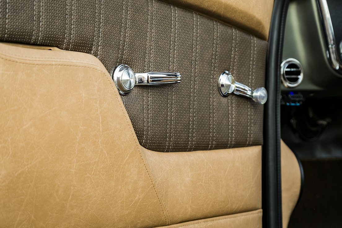 1969 Chevy C10 featuring Universal Pro Classic seats in SPORT-2 Tone design with distressed camel vinyl, a brown perforated vinyl center, and white contrast stitching. Includes matching dash pad, waterfall console, and door panels.