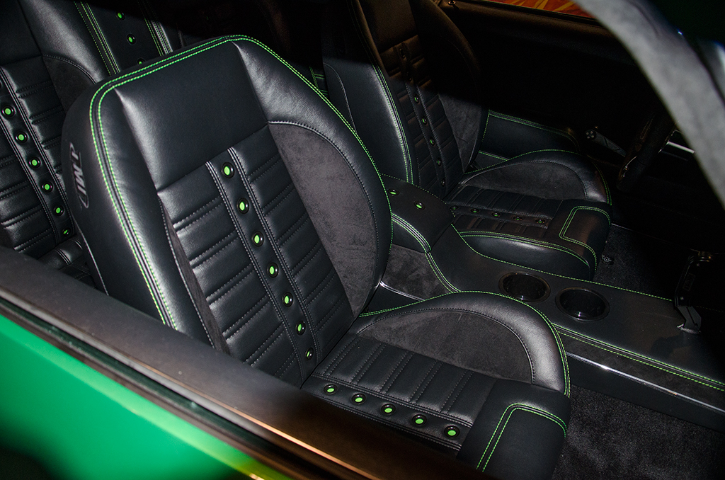 Featuring Universal Pro Series Low Back seats with SPORT-XR design with black vinyl, black suede, green contrast stitching and black grommets. Includes matching rear seat and center console with SPORT-R door panels.