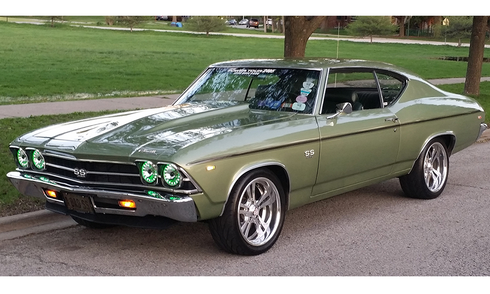 Chevelle featuring replacement standard SPORT-R seat with green vinyl and black suede. Includes matching rear seat.